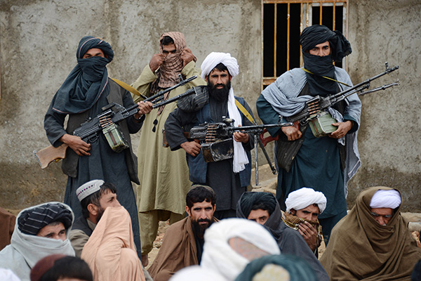 Afghan Taliban fighters listen to Mullah Mohammed Rasool, the newly-elected leader of a breakaway faction of the Taliban, in Farah province, Afghanistan. Senior members of the Afghan Taliban said on Thursday that a prominent figure within the militant group who had opposed its new leadership has now pledged his allegiance, helping to close divisions within the Taliban ahead of possible peace talks with the government.