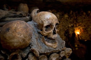 FILE - This is a  Tuesday, Oct. 14, 2014 filoe photo of skulls and bones are stacked at the Catacombs in Paris, France. The subterranean tunnels, which once gave refuge to smugglers and saints, cradle the bones of some 6 million Parisians from centuries past. The Catacombs form a dark, 200-mile (322 kilometer) underground labyrinth beneath the City of Light.  (AP Photo/Francois Mori)