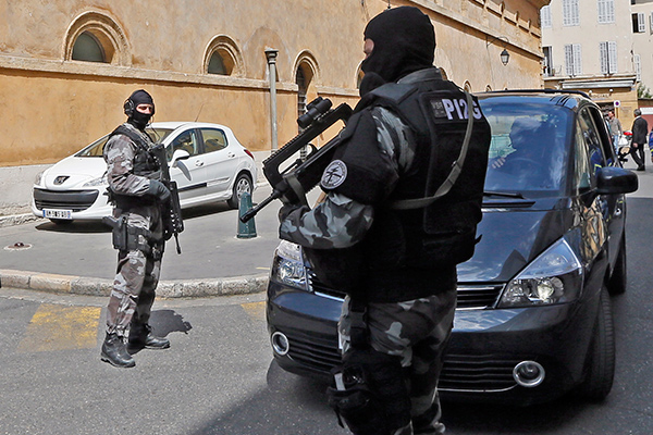 French gendarme special forces unit members secure an entrance of the courthouse during the transfer of the Naples-based Camorra mafia member Antonio Lo Russo in Aix-en-Provence April 16, 2014. Antonio Lo Russo, who was arrested in Nice yesterday by Italian and French police, is a member of the Naples-based Camorra mafia and one of Italy's 100 most-wanted fugitives.