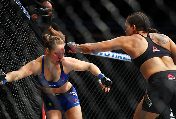 Amanda Nunes lands punches against Ronda Rousey during UFC 207 at T-Mobile Arena