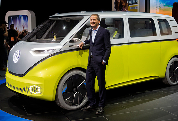 Dr. Herbert Diess, chairman of the Volkswagen brand, poses with the I.D. Buzz all-electric concept van, at the North American International Auto Show, Monday, Jan. 9, 2017, in Detroi
