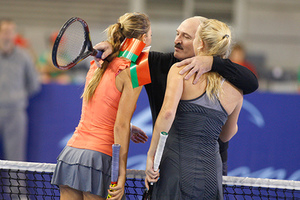 Belarusian President Alexander Lukashenko embraces Denmark's tennis star Caroline Wozniacki, right, and Belarus' Victoria Azarenka during charitable tennis match in Minsk, Belarus, Friday, Nov. 19, 2010.