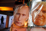 Face masks depicting Russian President Vladimir Putin and U.S. President-elect Donald Trump hang for sale at a souvenir street shop in St.Petersburg, Russia