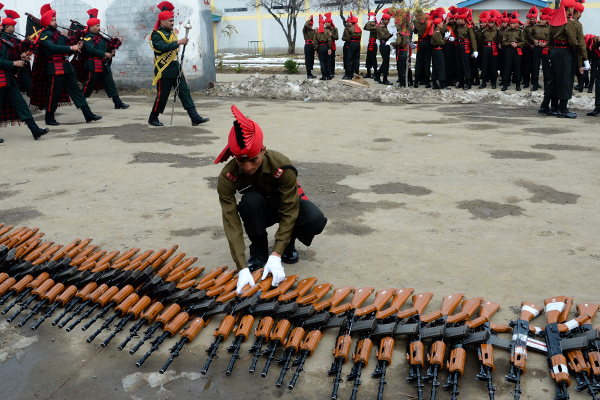 March 4, 2015 - Srinagar, Kashmir - SRINAGAR, INDIAN ADMINISTERED KASHMIR, INDIA - MARCH 04: A recruits of Indian armys soldier from Kashmir arrange INSAS (Indian Small Arms System) rifles after his passing out parade at Rangreth in a garrison on March