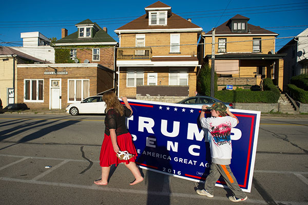 ABRIDGE, PA - OCTOBER 10: Two supporters of Republican candidate for President Donald J Trump leave after a rally where the candidate some to a crowd of 3000 at Ambridge Area Senior High School on October 10, 2016 in Ambridge, Pennsylvania. Ambridge, Pennsylvania, named after the American Bridge Company, a steel fabricating plant that employed 60,000 workers is a traditionally Democratic stronghold, but is shifting Republican as a shrinking tax base and lost jobs having devastating economic effects on the former industrial community.