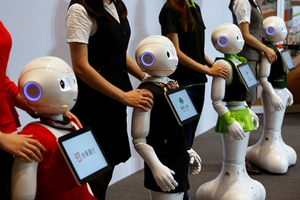 SoftBank's robots 'pepper', dressed in different bank uniforms, are displayed during a news conference in Taipei, Taiwan