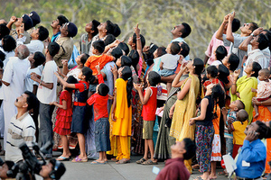People watch as India's Polar Satellite Launch Vehicle rocket takes off from the Satish Dhawan space center in Sriharikota, 90 kilometers (56 miles) north of Chennai, India, Monday, April 20, 2009. India on Monday launched the all-weather satellite to enhance its capability to monitor its sea and land borders and natural disasters, an official said. (AP Photo) ** INDIA OUT **