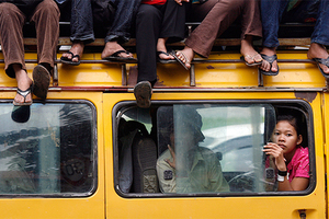DATE IMPORTED:July 26, 2008Cambodian ride on a van leaving Phnom Penh city for their hometown, at a bus station July 26, 2008 for voting day tomorrow. Cambodia is due to hold a general election on July 27.