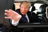 Real estate magnate Donald Trump waves as he leaves a Greater Nashua Chamber of Commerce business expo at the Radisson Hotel in Nashua, New Hampshire, May 11, 2011. Trump suggested Wednesday it's not much fun flirting with the idea of running for president in the face of relentless attacks and ridicule. REUTERS/Don Himsel/Pool (UNITED STATES - Tags: POLITICS)