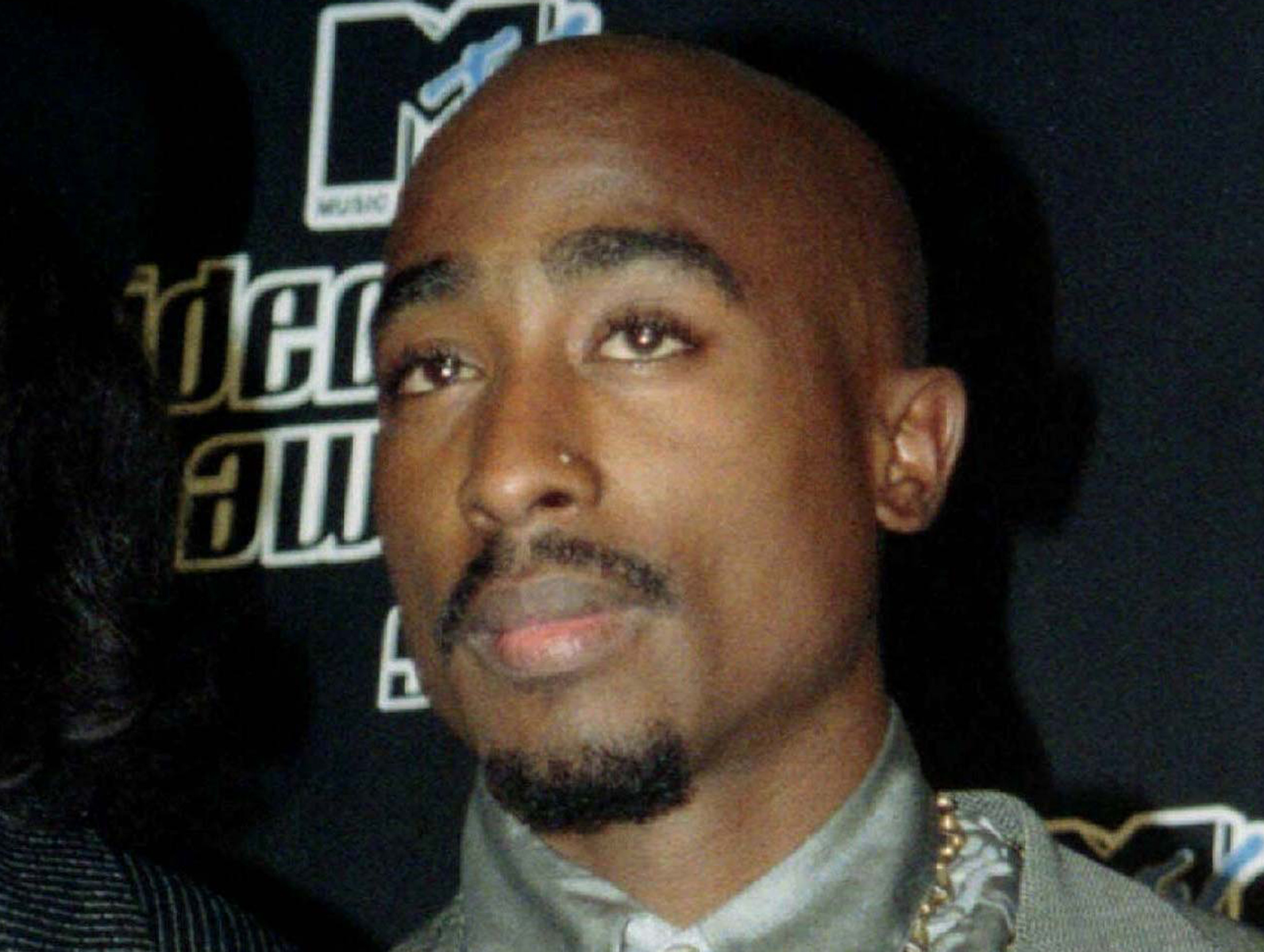 the early life and music successes of rapper tupac amaru shakur