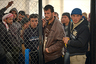 Refugees from Syria queue to collect food and supplies