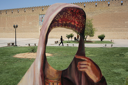 SHIRAZ, IRAN - MAY 29: A cutout of a woman in Iranian dress stands in front of the Karim Khani Palace, also a former prison, on May 29, 2014 in Shiraz, Iran. Shiraz, celebrated for more than 2,000 years as the heartland of Persian culture, is known as the home of Iranian poetry and for its progressive attitudes and tolerance. Like all of Iran, this week Shiraz observes the 25th anniversary of the death and continued legacy of the Ayatollah Khomeini, the father of the Islamic revolution.
