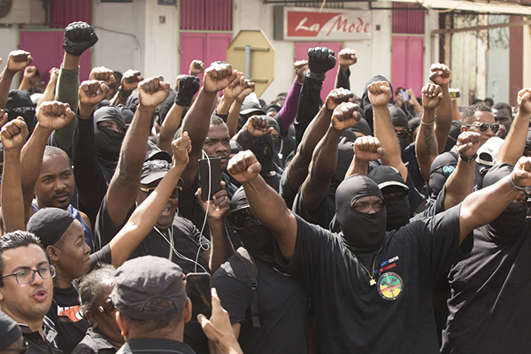 "Masked members of the collective ""500 Brothers"" take part in a march supporting a general strike in Cayenne, French Guiana, Tuesday, March 28, 2017. France announced Tuesday that it will send two high-level ministers to French Guiana as more than 10,000 protesters marched through the streets of the French territory in South America during the second day of a general strike over crime and economic hardship."