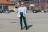 Фешен-блогер Каролина Даур перед показом Missoni: атласные спортивные брюки, высокие ботинки и шелковая блуза с плечами-буф.