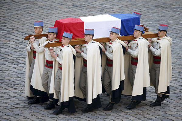 French Foreign Legionnaires carry the coffin of French politician Yves Guena during an official funeral ceremony at the Hotel des Invalides in Paris, France, March 8, 2016 REUTERS/Charles Platiau TPX IMAGES OF THE DAY