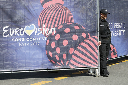 A policeman stands next to an entrance to the Eurovision Village, an official fan zone for the Eurovision Song Contest 2017, in central Kiev, Ukraine, May 3, 2017. REUTERS/Valentyn Ogirenko