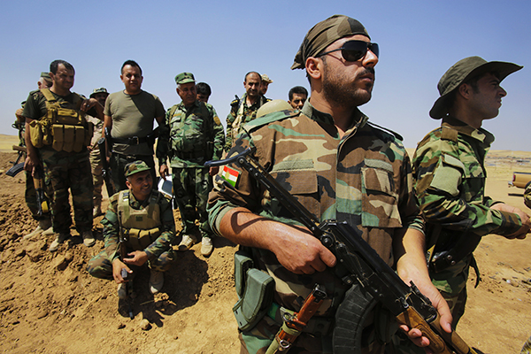 Kurdish Peshmerga forces guard their position at Omar Khaled village near Tal Afar, west of Mosul August 24, 2014. Peshmerga forces intensified their defences in the southern parts of the oil-rich city of Kirkuk on Saturday, defending ramparts just a few hundred metres away from Islamic State militants.