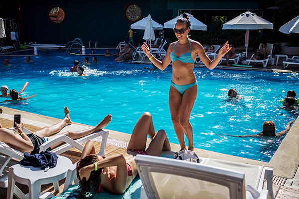 ourism In Turkey Continues To Struggle As Russia Lifts Travel Ban ANTALYA, TURKEY - JULY 13: Russian tourist Anastasia Goryachih dances poolside at a resort catering to primarily Russian tourists on July 13, 2016 in Antalya, Turkey. Russian President Vladimir Putin last month officially lifted travel restrictions on tourism to Turkey. Russia had banned agency tours to Turkey after a diplomatic crisis erupted when Turkey downed a Russian jet on the Turkey - Syrian border in November 2015. Turkey's tourism is currently in crisis after a series of terrorist attacks, most recently the bombing of Ataturk International Airport tourists numbers have plummeted. The tourist city of Antalya, popular with Russian and European tourists has been hit hard, in May overall visitor numbers to Turkey dropped 34.7 percent and according to figures released by Antalya airport, the number of Russian tourists had dropped 98.5 percent in June, creating one of the worst tourist seasons on record. Antalya is home to some 40,000 Russians permanently living and working in the city, with many working in the tourism sector, local businesses have have felt a ripple effect from the tourism downturn forcing job losses and business closures. The first Russian flight carrying package tourists to Turkey arrived in Antalya on July 9, 2016 bringing hope to local business and tour operators. (Photo by Chris McGrath/Getty Images)