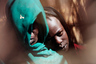 Displaced Sudanese Fatna Adam Hamed (R), 11, who was raped last Friday by unidentified armed men, leans on her mother's shoulder at her shelter at Otash Internally Displaced Persons (IDP) Camp in Nyala, southern Darfur