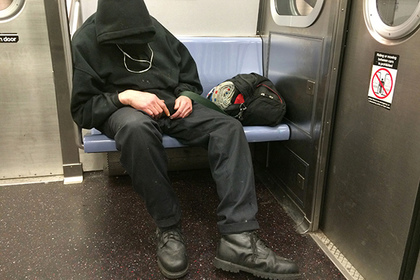 A man sleeps on a New York City subway, Tuesday, April 12, 2016. (AP Photo/Mark Lennihan)