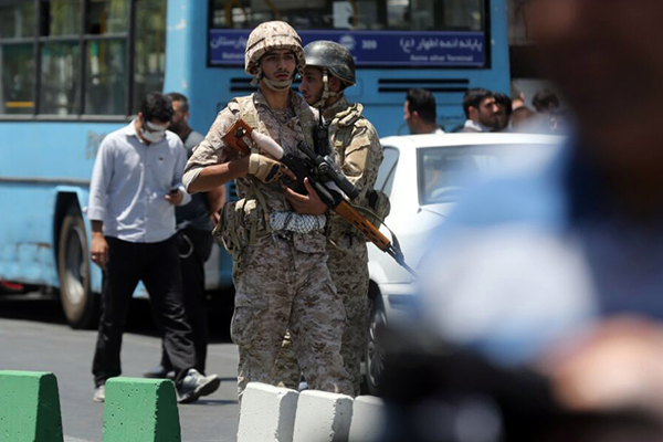 epa06014207 Iranian army soldiers stand near parliament building during an attack in Tehran, Iran, 07 June 2017. At least seven people were killed and several others were wounded following twin attacks on Iran's parliament building and the mausoleum of former supreme leader, Ayatollah Khomeini, in the Iranian capital Tehran on 07 June, according to official sources. EPA/HOSSEIN MERSADI
