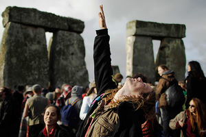 reaches up to the sky during the summer solstice at Stonehenge, near Salisbury in England, Tuesday, June 21, 2011. The ancient stone circle of Stonehenge is a World Heritage Site erected between approximately 3000BC and 1600BC and despite years of research the reason behind its construction remains a mystery. The summer solstice in the northern hemisphere occurs annually on June 21 and is the time at which the sun is at its northernmost point in the sky.
