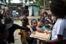 Дети разбирают гуманитарную помощь, присланную в «Божий город» одной из неправительственных организаций.