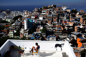 "A woman sits on a terrace at Tiki hostel in Cantagalo favela, in Rio de Janeiro, Brazil, April 16, 2016. Hostels in a few of RioÕs more than 1,000 slums serve not only as a cheap housing alternative for the more adventurous among the estimated 500,000 foreign tourists expected to arrive for the Olympics in August. The establishments also open up the rich culture of the city's shantytowns for travellers, giving them a glimpse into once ""no-go"" areas where about one-fifth of Rio's population lives. REUTERS/Pilar Olivares SEARCH ""HOLIDAY FAVELAS"" FOR THIS STORY. SEARCH ""THE WIDER IMAGE"" FOR ALL STORIES TPX IMAGES OF THE DAY"