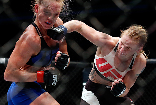 FILE - In this July 23, 2016, file photo, Valentina Shevchenko, right, of Kyrgyzstan, punches Holly Holm during a women's bantamweight mixed martial arts bout in Chicago. Holly Holm is already the answer to a trivia question as the first fighter to dominate and defeat Ronda Rousey. Holm's championship reign lasted only four months, and another loss soon followed that left Holm not as the heir apparent to Rousey in the women's division, but rather on the cusp of being labeled an MMA version of a one-hit wonder like Buster Douglas. (AP Photo/Nam Y. Huh, File)