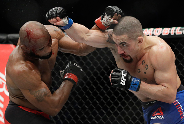 Yoel Romero, left, fights Robert Whittaker in a middleweight championship mixed martial arts bout at UFC 213, Saturday, July 8, 2017, in Las Vegas. (AP Photo/John Locher)