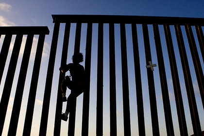 :  January 26, 2017 - Tijuana, Baja California, MEXICO - After President Trump signed executive orders to build a border wall, crack down on 'sanctuary cities' and bar Syrian refugees the White House floats a 20 percent import tax to pay for the Mexican Wall on Thursday January 26, 2017. FILE PHOTO: A man climbs the fence dividing the United States and Mexico on Monday 6 August 2007 in Tijuana, Baja California, Mexico. (Credit Image: Global Look Press via ZUMA Press) Photographer: © Adrian Sanchez-Gonzalez