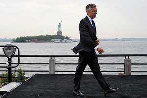 Former Utah Gov. Jon Huntsman walks on a platform Tuesday, June 21, 2011, at Liberty State Park in Jersey City, N.J., after announcing his bid for the Republican presidential nomination, (AP Photo/Mel Evans)