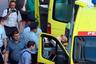 Транспортировка раненого к автомобилю скорой помощи