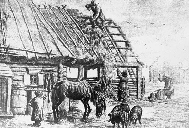 Крестьяне сбрасывают с крыши солому для корма скота