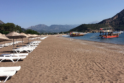 FILE - In this June 1, 2016 file photo, boats wait for tourists in Adrasan in Olympos area, about 100 kilometers west of Antalya, Turkey. With summer drawing to a close, Turkey is counting the cost of a tough year that saw a string of terrorist bombings and a diplomatic spat with Moscow that cut deep into the country's crucial tourist trade.