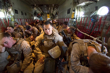 August 22, 2017 - (FILE PHOTO) - US President Donald Trump has announced he would prolong the US military intervention in Afghanistan. PICTURED: Oct. 27, 2014 - Camp Leatherneck, Helmand Province, Afghanistan - At Bastion Airfield in Helmand Province, some of the last Marines left on Camp Leatherneck who earlier handed over their guard post to their Afghan National Army counterparts crowd into a C-130 for the official withdrawal of U.S. Marines from Helmand Province. (Credit Image: Global Look Press via ZUMA Press) Photographer: © Nelvin C. Cepeda