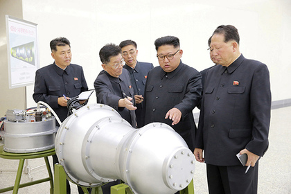 REFILE - ADDITIONAL INFORMATION North Korean leader Kim Jong Un provides guidance with Ri Hong Sop (2nd L) and Hong Sung Mu (R) on a nuclear weapons program in this undated photo released by North Korea's Korean Central News Agency (KCNA) in Pyongyang September 3, 2017.
