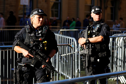 Armed police officers stand near one of the entrances to the Manchester Arena in Manchester, Britain September 9, 2017. REUTERS/Phil Noble