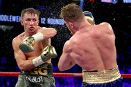 LAS VEGAS, NV - SEPTEMBER 16: (L-R) Gennady Golovkin throws a punch at Canelo Alvarez during their WBC, WBA and IBF middleweight championionship bout at T-Mobile Arena on September 16, 2017 in Las Vegas, Nevada. (Photo by Al Bello/Getty Images)