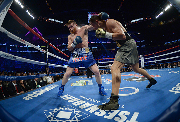 Sep 16, 2017; Las Vegas, NV, USA; Gennady Golovkin (green trunks) and Canelo Alvarez (blue trunks) box during the world middleweight boxing championship at T-Mobile Arena. The bout ended in a draw. Mandatory Credit: Joe Camporeale-USA TODAY Sports