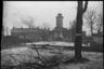 В освобожденной от немцев Гатчине горят подожженные гитлеровцами дома. Ленинградский фронт, 1943 год.