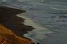 Роскошный пляж за «Орбитой» на берегу Тихого океана. Четырехкилометровая песчаная полоса — традиционное место прогулок курильчан и гостей острова. Правда, красивые виды и воздух время от времени портит расположенная в непосредственной близости поселковая свалка, мусор с которой периодически попадает на побережье.