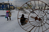 Демонтаж новогодних декораций на центральной площади Южно-Курильска.