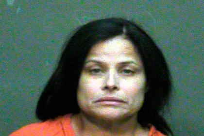 Американку приговорили к пожизненному за убийство дочери распятием