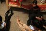 Китайские туристы в квартире местных, переоборудованной под хостел.