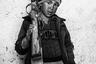 Au Bala означает «высокая вода» на языке дари (восточный вариант персидского). Населенный пункт с таким названием расположен в долине Фулади, недалеко от Бамиана в Афганистане. <br> <br> Фотограф Эндрю Куилти многие годы мечтал побывать в Афганистане — с тех пор, как впервые увидел снимки жителей этой страны. «Я видел фотографии мальчиков и их самодельные лыжи — грубые доски. Они были из Бамиана, что в центральном нагорье Афганистана, известного гигантскими Буддами, высеченными в скалах 1500 лет назад и уничтоженными талибами всего за несколько месяцев до того, как США провели военную операцию по свержению режима в 2001 году».  <br> <br> В то время как многие афганцы, чтобы выглядеть солиднее, копили на соответствующие лыжные штаны, куртки и прочую амуницию, эти мальчики носили в основном традиционную афганскую одежду с обычной обувью или пластиковыми сандалиями.  <br> <br> Когда Куилти приехал в страну, он тут же направился в «лыжный» регион. Куилти мечтал найти маленьких спортсменов и сфотографировать их на деревянных лыжах. Удача улыбнулась ему уже через пару часов после приезда в страну: он встретился на близлежащей горнолыжной трассе с Алишахом Фархангом, красивым 27-летним лыжником в зеркальных солнцезащитных очках. Фарханг, как оказалось, был одним из двух лучших. Он мечтал представлять свою страну на зимних Олимпийских играх в гигантском слаломе.  <br> <br> Поблизости Куилти нашел поселок Au Bala, где практически все увлекаются катанием. «Афганцы — замечательная портретная тематика. Они смотрят в объектив строго, экспрессивно, но с гордостью», — сказал фотограф. Он сделал несколько портретов маленьких жителей. Во время съемки их лыжи стояли прислоненными к стене, освещенные зимним солнцем и светом от тающего снега.  <br> <br> Профессиональный конкурс, шорт-лист.