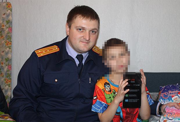 Андрей Довыденков со спасенным Никитой