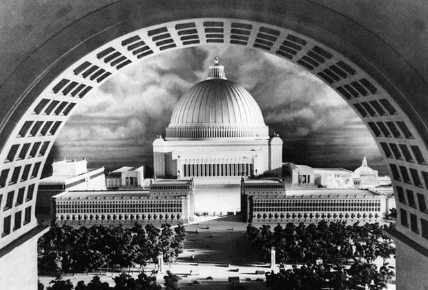По задумке Гитлера, к середине ХХ века Берлину предстояло быть переименованным в «столицу мира Германию» (Welthauptstadt Germania). Шпеер разработал по заказу фюрера «Общий план застройки имперской столицы», предусматривавший, в частности, строительство к северу от Рейхстага «Зала народа» — огромного, 315 на 315 метров в основании, здания под куполом. Рядом с залом планировали построить берлинскую резиденцию Гитлера — Дворец фюрера.