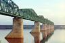 Строительство первого железнодорожного моста через Каму началось под Пермью в 1897 году и длилось два года. Мост состоял из десяти пролетов, сборка ферм производилась в мастерских Березина методом горячей клепки. Все фермы были сделаны из сварочного железа, изготовленного на Воткинском заводе. Металлические части моста весили более 254 тысяч пудов (4160 тонн).