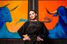 Художница Ирина Панасенко на фоне своих работ